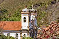 Side view of historic church in baroque and colonial style from the 18th century amid the hills and vegetation
