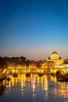 Sunset on Tiber river bridge with Vatican City - Rome, Italy