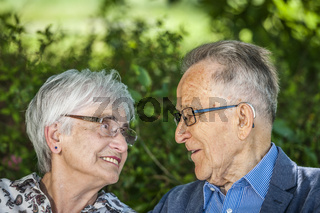 Pensioners look each other in the eye