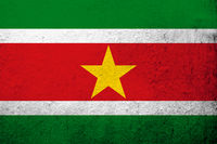 The Republic of Suriname National flag. Grunge background