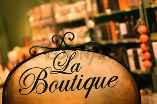 Board at the store in antique style with the word 'boutique'