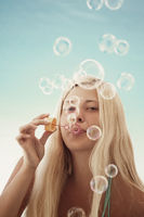 Blonde woman and soap bubbles in summertime, travel and beach lifestyle