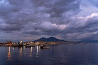 Naples harbor at sunset with Vesuvius volcano, Italy.