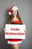 Frohe Weihnachten - Weihnachtsfrau mit Schild