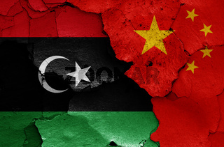 flags of Libya and China painted on cracked wall
