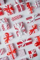 Various pattern and size Christmas boxes placed on white background. Wrapped in festive paper