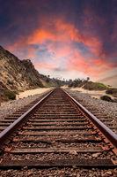 Sunset over Train tracks run through San Clemente State Beach