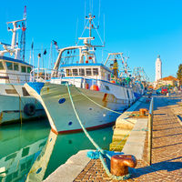 Ships on canal by lighthous in Rimini