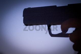 Pistol revolver silhouette hand shooting gun