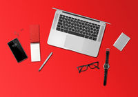 Office desk mockup top view isolated on red
