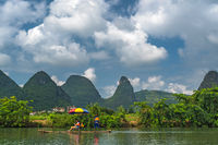 Tourists on bamboo rafts on Yulong River in Yangshuo