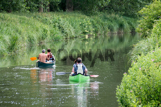 Canoeing on the Kennet and Avon Canal near Aldermaston Berkshire on July 5, 2015. Unidentified people.