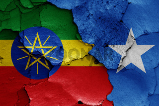 flags of Ethiopia and Somalia painted on cracked wall