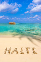 Word Haiti on beach