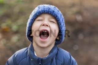 Cheerful preschool kid outdoors