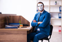 Young male employee wearing mask in the office