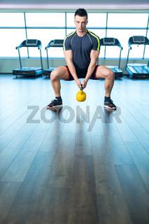 Man at the gym exercising