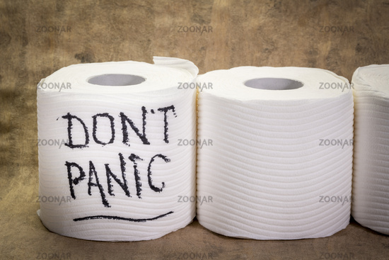 do not panic message - handwriting on a roll of a toilet paper,