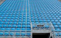 Blue plastic empty stadium  chairs in a row