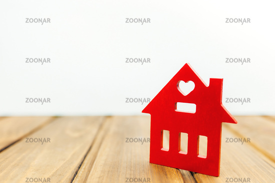 Little wooden red house on the background