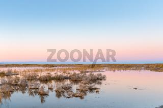 saline and alkaline land in sunset
