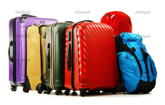 Luggage consisting of large suitcases and rucksacks isolated on white.