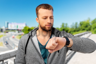 man with smart watch outdoors