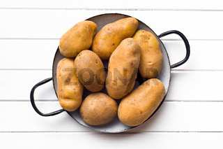 uncooked potatoes in pot