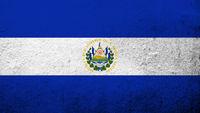 The Republic of El Salvador National flag Land of Superb Volcanoes. Grunge background