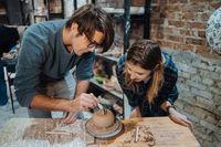 Making a handmade clay pot. Pottery lesson, hobby.
