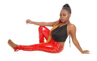 Gorgeous African woman in red latex pants