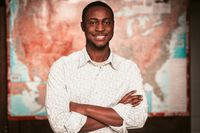 Young Black Entrepreneur On American Map Background