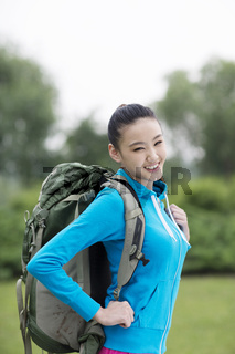 Young woman with backpack in outdoor