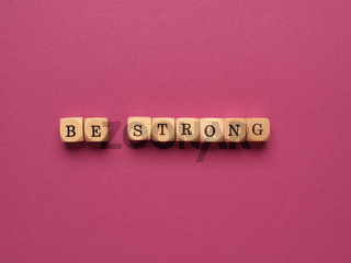 Be strong written with small wooden blocks