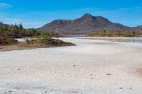 Salt plain landscape with mountain on Bonaire