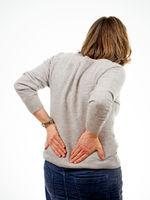 Frau hält ihren Rücken