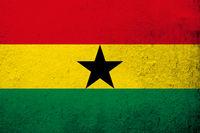 The Republic of Ghana National flag. Grunge background