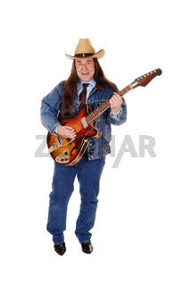 Middle age man standing playing the guitar