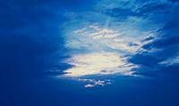 Dramatic cloudy sky at sunrise