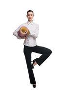 Businesswoman with yoga mat balancing on leg