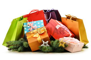 Colorful gift boxes and paper bags isolated on white background.