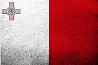 The Republic of Malta National flag. Grunge background
