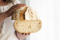 Sourdough bread hold in hands. No yeast bread