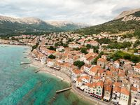 Aerial panoramic view of Baska town, popular touristic destination on island Krk, Croatia, Europe.