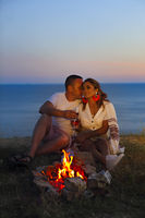 Beautiful couple in love on the beach at night