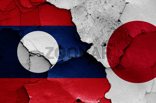 flags of Laos and Japan painted on cracked wall