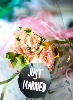 Just married bouquet on blurred colored background