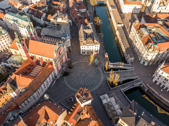Aerial drone view of Preseren Squere and Triple Bridge over Ljubljanica river,Tromostovje, Ljubljana, Slovenia. Empty streets during corona virus pandemic social distancing measures
