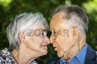 Seniors in love nose to nose
