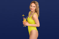 Attractive trendy blond woman with exotic cocktail